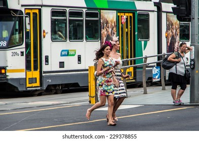 MELBOURNE, AUSTRALIA - November 4, 2014: on the Melbourne Cup Day public holiday, racegoers return from Flemington Racecourse after the end of the Melbourne Cup horse race,at Flinders Street Station.