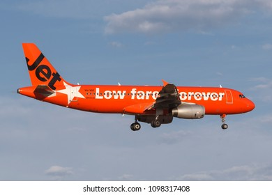 "Melbourne, Australia - November 8, 2014: Jetstar Airways Airbus A320 VH-VGT at Melbourne International Airport in a bright orange ""#jetstargeneration"" livery."