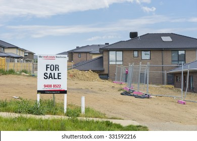 Melbourne, Australia - October 11, 2015: For sale sign on display outside vacant land in Melbourne's suburb during daytime.