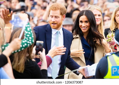 MELBOURNE, AUSTRALIA - OCTOBER 18: Prince Harry, Duke of Sussex and Meghan Markle, Duchess of Sussex meet fans at Government House in Melbourne, Australia