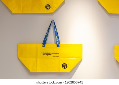 Melbourne, Australia - October 4, 2018: Yellow IKEA bags hanging on a wall
