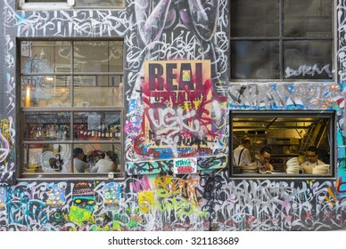 Melbourne, Australia - September 18, 2015:  View of customers and chefs in a restaurant in Hosier Lane, Melbourne. Hosier Lane is one of the city's best street art locations.