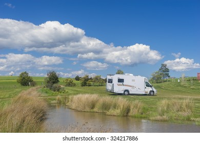Melbourne, Australia - September 19, 2015: View of motorhome in meadow in blue sky in the countryside of the Yarra Ranges in Melbourne.