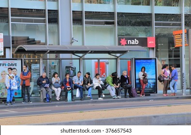 MELBOURNE AUSTRALIA - SEPTEMBER 19, 2015: Unidentified people wait at bus stop in Melbourne city centre. Bus is one of the key public transport in Melbourne.