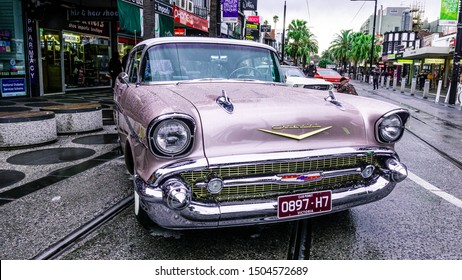 Melbourne, Australia -September 2019: Chevrolet Bel Air classic car parked in the street after the rain. Wet drops over it. Family event at St Kilda car show during the first day of spring.