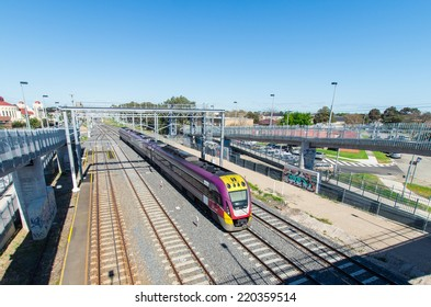 MELBOURNE, AUSTRALIA - September 21, 2014: a V-Line train departing Springvale.  V-Line provides regional rail transport, connecting Melbourne with regional and interstate destinations.