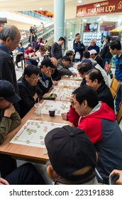 MELBOURNE, AUSTRALIA - September 21, 2014: men playing Chinese chess  in the Springvale Shopping Centre, an ethnically diverse suburb.