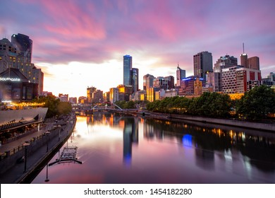 Melbourne, Australia, Wednesday 30 December 2015 : Cityscape of business building along Yarra River with beautiful sunset sky in Southbank area, Melbourne city, Victoria