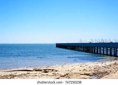 Melbourne, Australia-Feb 21, 2017: Quiet seaside view with a wooden pontoon bridge in Brighton beach.