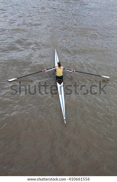 Melbourne, Australia-May 26, 2012. Female rower in a single scull on the Yarra River, Melbourne, Victoria, Australia