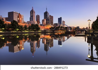 Melbourne capital city CBD reflection at waterfront of Yarra river at sunrise time still scene