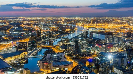 Melbourne City Aerial View Panorama Skyline Cityscape, Harbour, Seafarers Bridge, Bolte Bridge over Yarra River at Dusk Evening Sunset from Eureka Tower on South Bank, Victoria, Australia