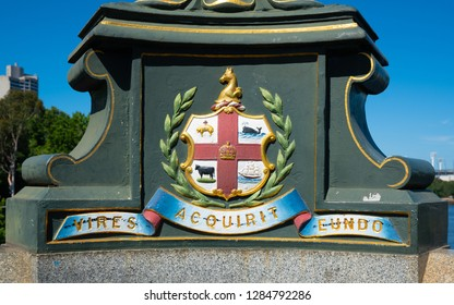 Melbourne city coat of arms and Latin motto Vires Acquirit Eundo on Princes bridge in Victoria Australia translation: We gather strength as we go