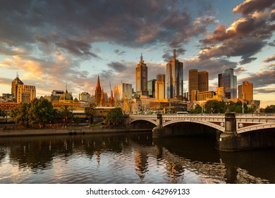 Melbourne City Panorama, Yarra River, Princes Bridge with Reflection Cityscape Skyline background under dramatic Golden Sky Sunset, Australia