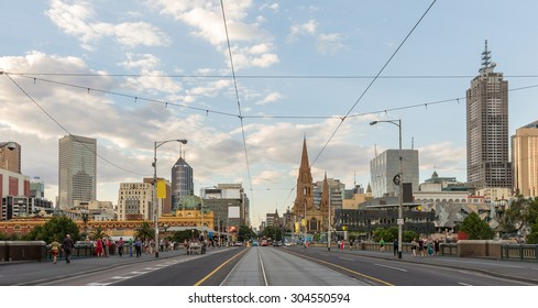 Melbourne City Skyline Panorama on  Melbourne tramway street while Crossing Princes Bridge from Southbank at Sunset in Summer