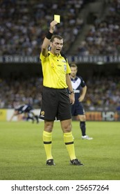 MELBOURNE - FEBRUARY 14: A-league Major Semi Final - Melbourne Victory 4 defeat Adelade United 0. Referee Matthew Breeze gives Cassio a yellow card on February 14, 2009 in Melbourne.
