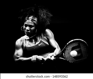 MELBOURNE - JANUARY 17: Serena Williams of the USAin her second round win over Garbine Muguruza of Spain at the 2013 Australian Open on January 17, 2013 in Melbourne, Australia.