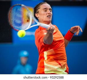 MELBOURNE - JANUARY 18: Alexandr Dolgopolov of the Ukraine in his second round win over Tobias Kamke of Germany at the 2012 Australian Open on January 18, 2012 in Melbourne, Australia.