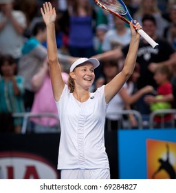 MELBOURNE - JANUARY 18: Ekaterina Makarova  of Russia celebrates her first round win over Ana Ivanovic of Serbia  in the 2011 Australian Open - January 18, 2011 in Melbourne