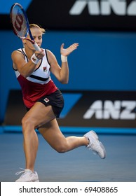 MELBOURNE - JANUARY 19: Jelena Dokic of Australia in her second round loss to Barbora Zahlavova Strycovaof the Czech Republic in the 2011 Australian Open on January 19, 2011 in Melbourne, Australia