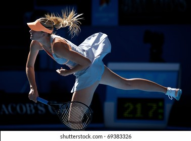 MELBOURNE - JANUARY 19: Maria Sharapova of Russia in her second round win over Virginie Razzano of France in the 2011 Australian Open - January 19, 2011 in Melbourne