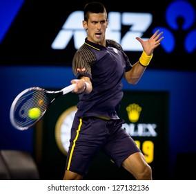 MELBOURNE - JANUARY 20: Novak Djokovic of Serbia in his marathon fourth round win over Stanislas Wawrinka at the 2013 Australian Open on January 20, 2013 in Melbourne, Australia.