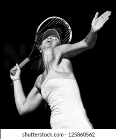 MELBOURNE - JANUARY 22: Maria Sharapova of Russia in her quarter final win over Ekaterina Makarova of Russia at the 2013 Australian Open on January 22, 2013 in Melbourne, Australia.