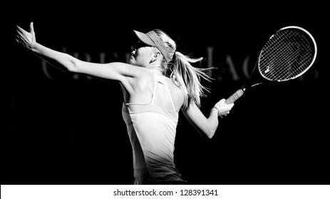 MELBOURNE - JANUARY 22: Maria Sharapova of Russia in her quarter final win over Ekaterina Makarova of Russia at the 2013 Australian Open on January 22, 2013 in Melbourne, Australia.