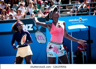 MELBOURNE - JANUARY 22: Venus (R) and Serena Williams of the USA in a doubles match at the 2013 Australian Open on January 22, 2013 in Melbourne, Australia.