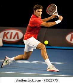 MELBOURNE - JANUARY 22:Roger federer of Switzerland in hiw fourth round win over Bernard Tomic of Australia at the 2012 Australian Open on January 22, 2012 in Melbourne, Australia.