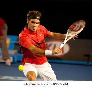 MELBOURNE - JANUARY 22:Roger federer of Switzerland in hiw fourth round win over Bernard Tomic of Australia at the 2012 Australian Open on January 22, 2012 in Melbourne, Australia.