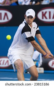 MELBOURNE - JANUARY 23: Andy Roddick of the USA returns a serve at the Australian Open Tennis Grand Slam Event on January 23, 2009 in Melbourne.