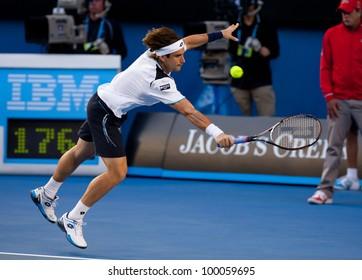 MELBOURNE - JANUARY 25: David Ferrer of Spain in his quarter final loss to  Novak Djokovic of Serbia at the 2012 Australian Open on January 11, 2012 in Melbourne, Australia.