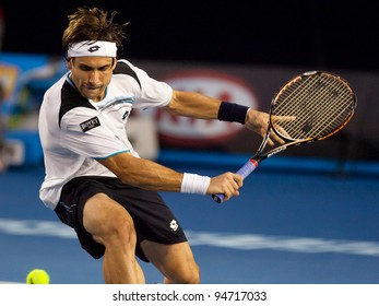 MELBOURNE - JANUARY 25: David Ferrer of Spain in his quarter final loss to  Novak Djokovic of Serbia at the 2012 Australian Open on January 25, 2012 in Melbourne, Australia.