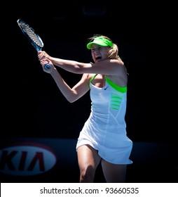 MELBOURNE - JANUARY 25: Maria Sharipova of Russia in her quarter final win over Ekaterina Makarova of Russia at the 2012 Australian Open on January 25, 2012 in Melbourne, Australia.