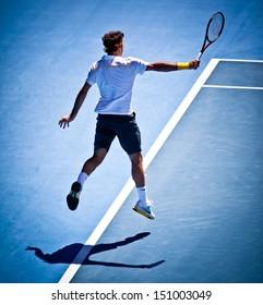 MELBOURNE - JANUARY 25: Roger Federer of Switzerland in his quarter final win over Stanislas Wawrinka of Switzerland in the 2011 Australian Open on January 25, 2011 in Melbourne, Australia