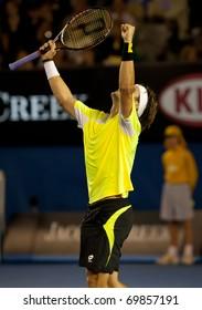 MELBOURNE - JANUARY 26: David Ferrer of Spain celebrates his quarter final win over Rafael Nadal of Spain  in the 2011 Australian Open on January 26, 2011 in Melbourne, Australia