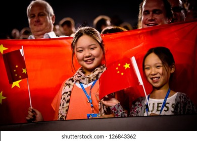 MELBOURNE - JANUARY 26: Fans with Chinese flag at the Australian Open Womens final between Li Na of China andVictoria Azarenka of Belarus on January26, 2013 in Melbourne, Australia.