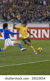 MELBOURNE - JUNE 17: Tim Cahill shoots at goal. Australian Socceroos-2 defeat Japan-1 in the 2010 World Cup Qualifying at the MCG (Melbourne Cricket Ground) June 17, 2009 in Melbourne, Australia.