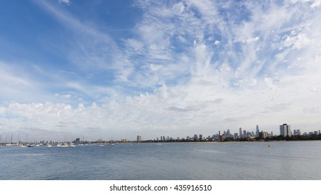 Melbourne - March 3, 2016: View from a wooden jetty over the city of Melbourne with a berth in the Port Phillip Bay in Victoria and many yachts March 3, 2016, Melbourne, Australia