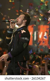 MELBOURNE - MARCH 5: Singer Chris Martin from British alternative rock band Coldplay performs onstage at Rod Laver Arena on March 5, 2009 in Melbourne, Australia.
