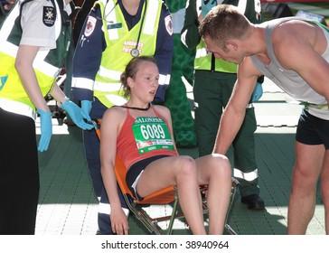 MELBOURNE - OCTOBER 11: A competitor receives medical attention upon completion of the 2009 Melbourne marathon October 11, 2009 in Melbourne.