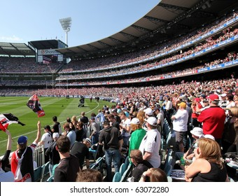 MELBOURNE - OCTOBER 2: Crowd at the Collingwood vs St Kilda AFL Grand Final at the MCG - October 2, 2010 in Melbourne, Australia.