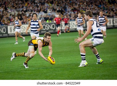 MELBOURNE - SEPTEMBER 9 : Sam Mitchel with the ball during Geelong's win over Hawthorn - September 9, 2011 in Melbourne, Australia.
