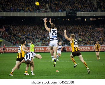 MELBOURNE - SEPTEMBER 9 : Tom Hawkins(C) leaps for a mark during Geelong's win over Hawthorn - September 9, 2011 in Melbourne, Australia.
