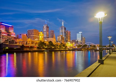 Melbourne skyline at twilight, reflected in the Yarra River.