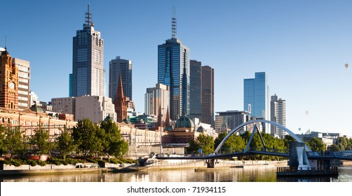 Melbourne skyline and the Yarra Footbridge leading to Flinders Street Station