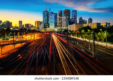 Melbourne train station with Melbourne city background in sunset, Australia, this image can use for travel and transportation.