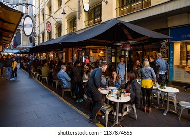 Melbourne, VIC / Australia - June 10 2018: Degraves Street, the laneway full of cafe, restaurants, shops, and tourists