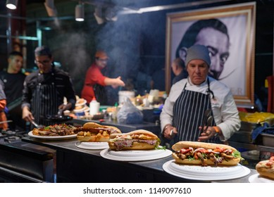 Melbourne, VIC / Australia - June 13 2018: A chef behind a food stall in Queen Victoria Winter Night Market